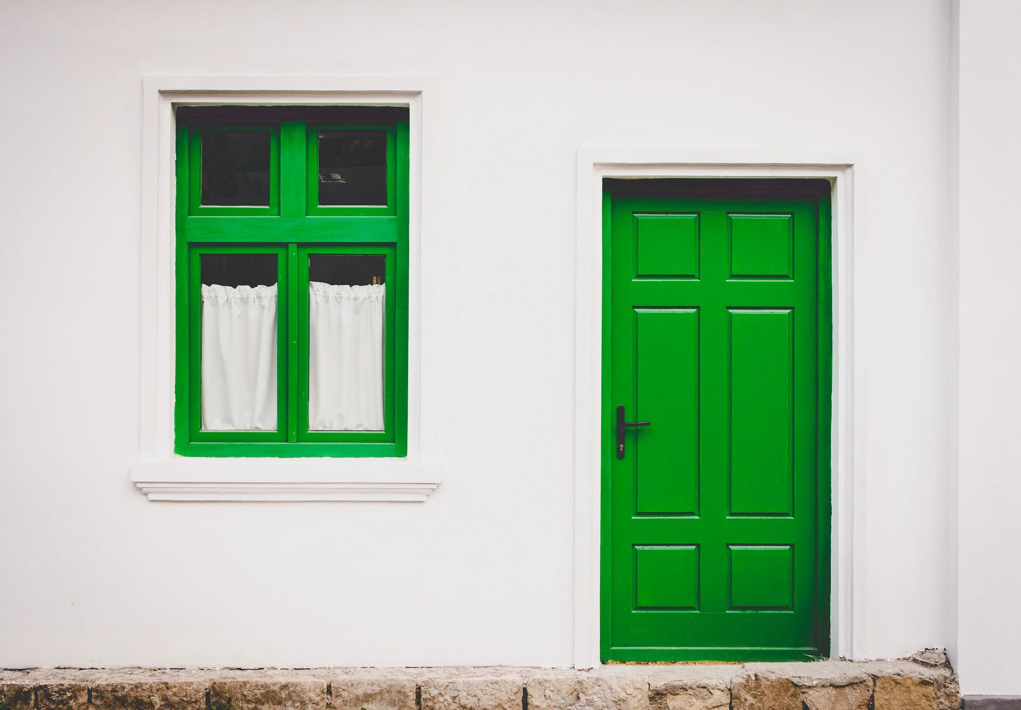 Green door and window - New paint makes real estate more appealing