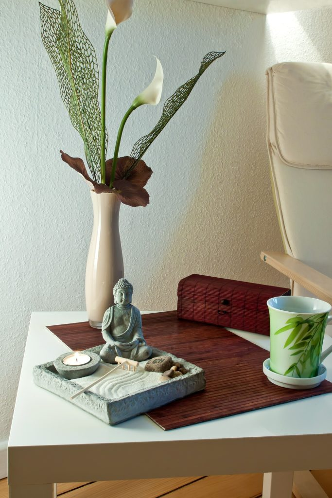 Sand garden and coffee cup with lilies to create a relaxing atmosphere